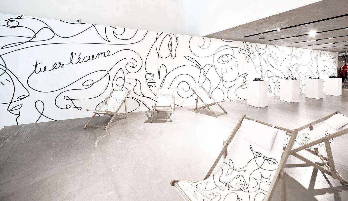 черно-белые муралы на стенах нарисованные линией